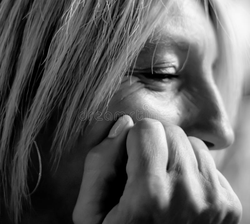Blond woman looking forward detail of face. black and white photography. stock photos