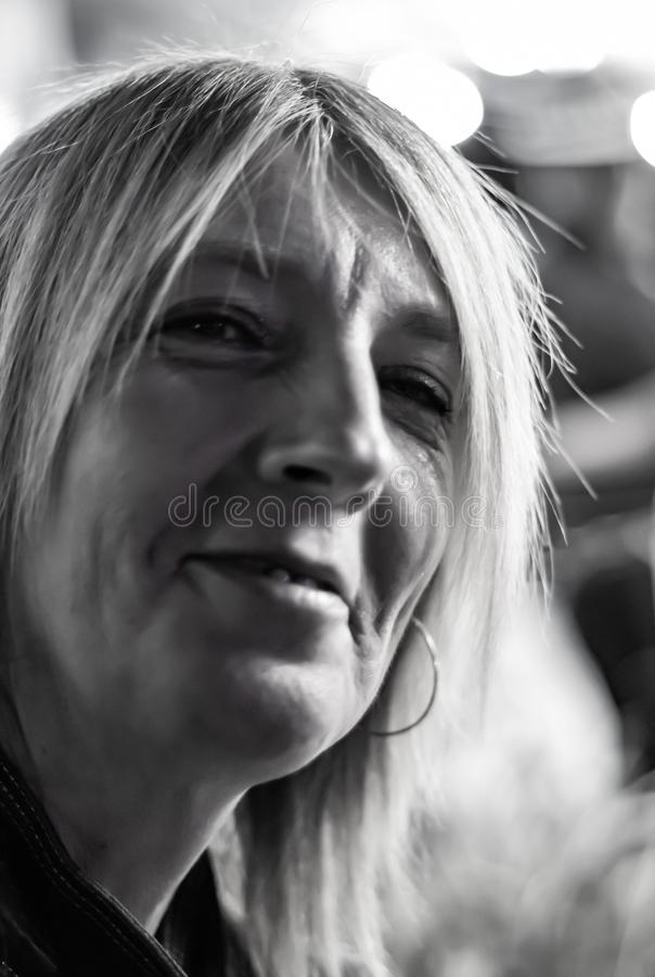 Blond woman looking forward detail of face. black and white photography. stock images
