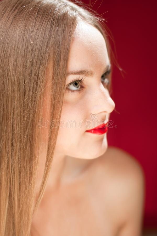 Download Blond Woman Looking At Red Copyspace Stock Photo - Image of closeup, holding: 21207000
