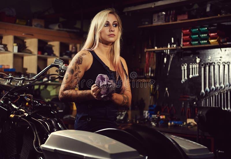 Blond woman mechanic stock photos