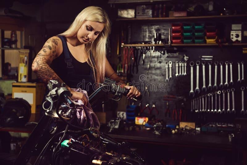 Blond woman mechanic stock images