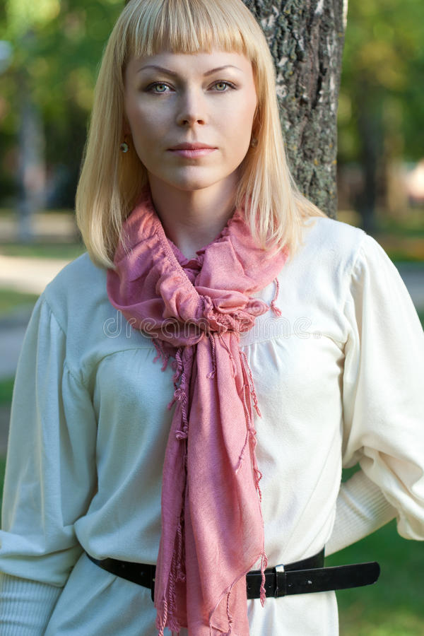 Download Blond woman near tree stock image. Image of attractive - 22713871