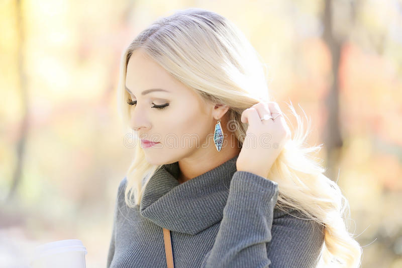 Blond woman in outdoor portrait stock images