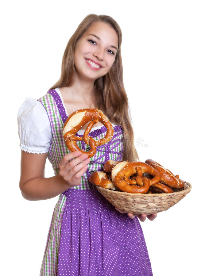 Blond woman in a purple dress loves pretzels. On an isolated white background for cut out stock photo