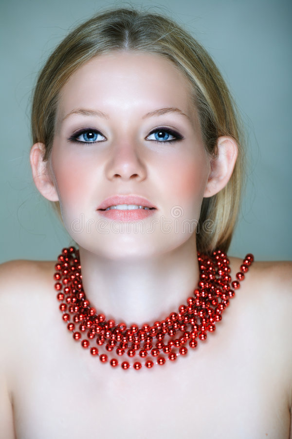 Blond woman with red beads