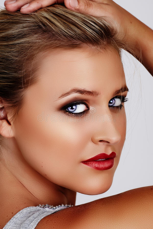 Blond woman with red lipstick stock image