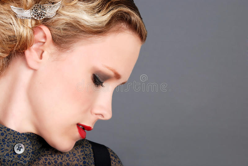 Blond woman with red lipstick side profile royalty free stock images