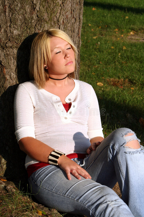 Blond Woman Sitting & Sunning royalty free stock images