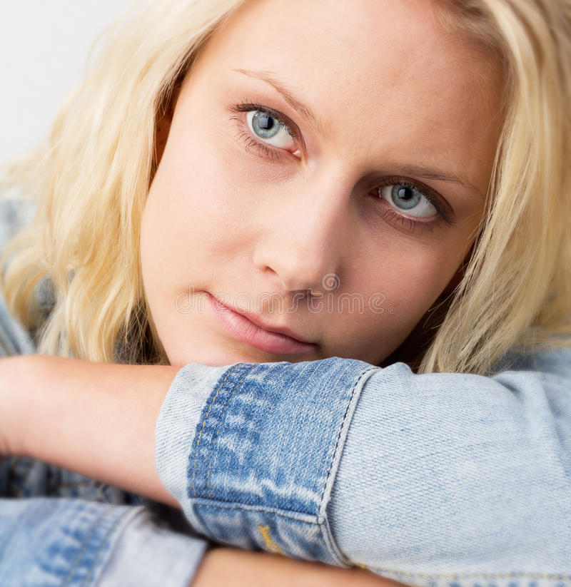 Blond woman with a soft smile stock photos