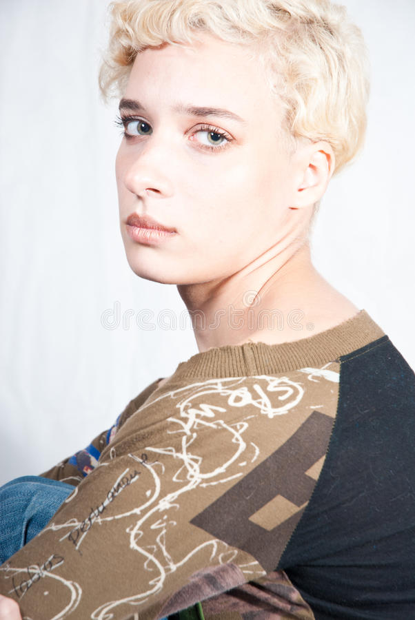 Blond woman studio portrait stock image