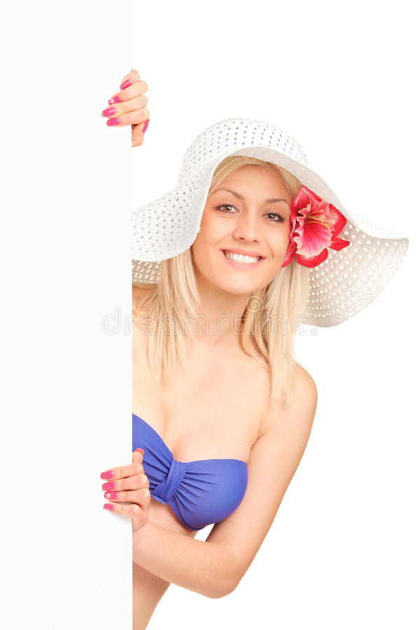 Download Blond Woman In Swimsuit Holding A Panel Stock Image - Image: 25521851