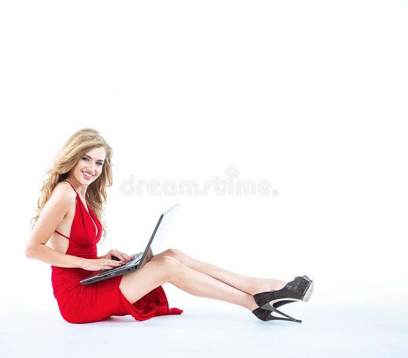 Blond lady using a notebook - isolated royalty free stock photos