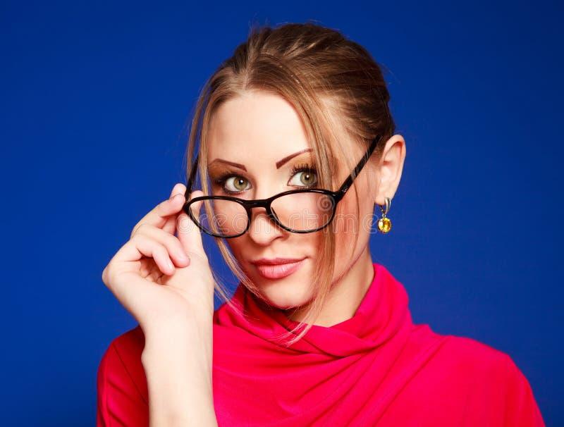 Blond woman wearing glasses stock photo
