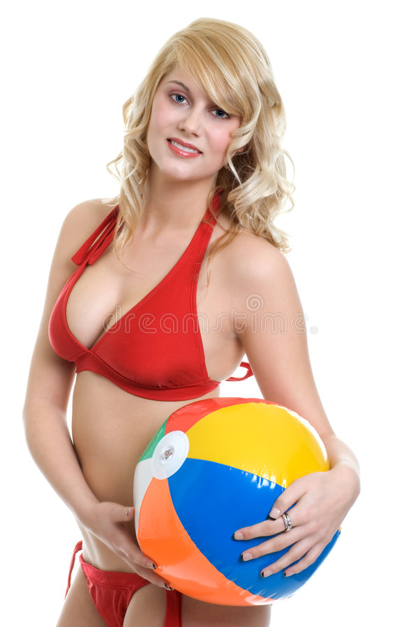 Blond woman wearing red bikini holding beach ball stock photography