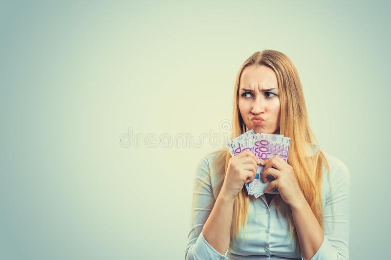 Greedy woman with pile of money stock image