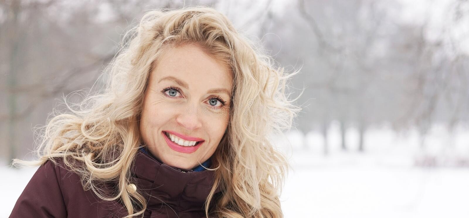 Blond woman in winter landscape banner stock image