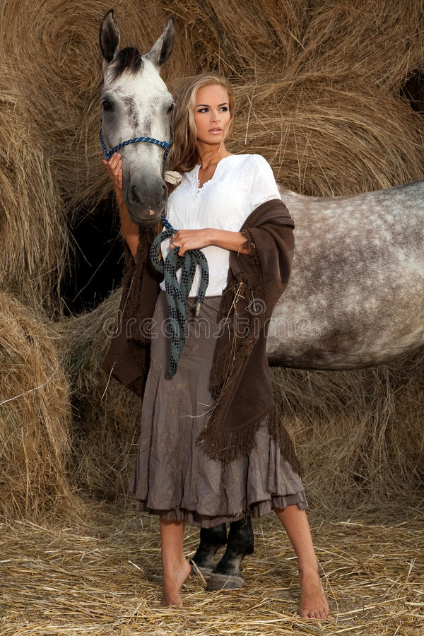 Free Blond Woman With Horse Stock Photos - 20635933