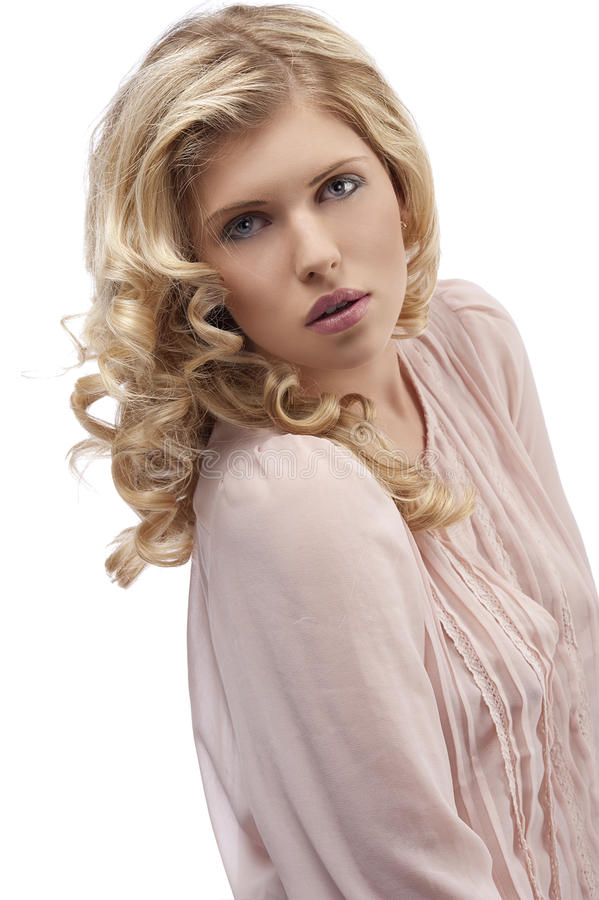 Blond young girl with curly hair looking towards royalty free stock images