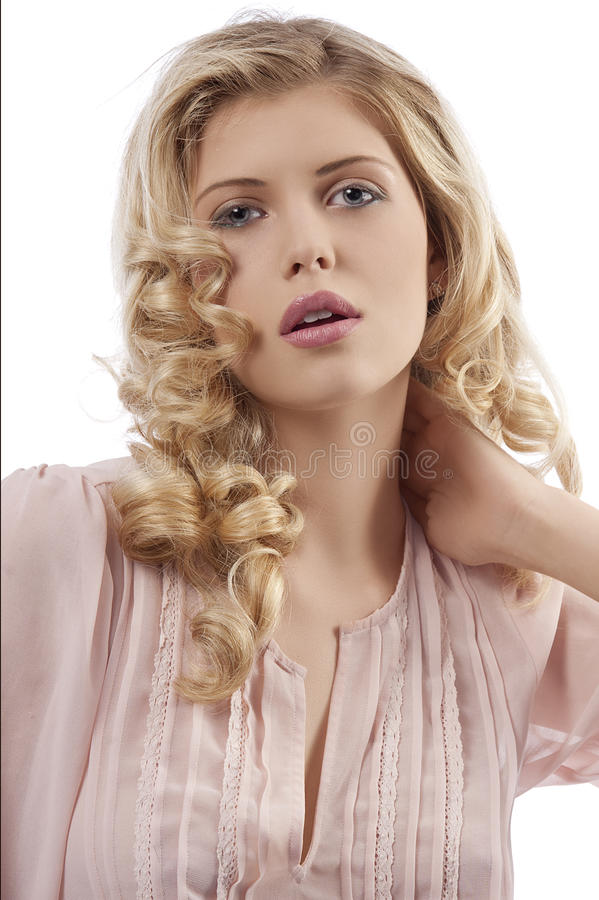 Blond young girl with curly hair posing royalty free stock photography