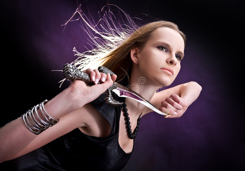 Download Blond Young Girl Holding Dagger Stock Image - Image: 8008685