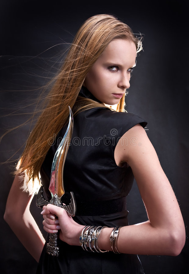 Download Blond Young Girl Holding Dagger Stock Image - Image: 8008767