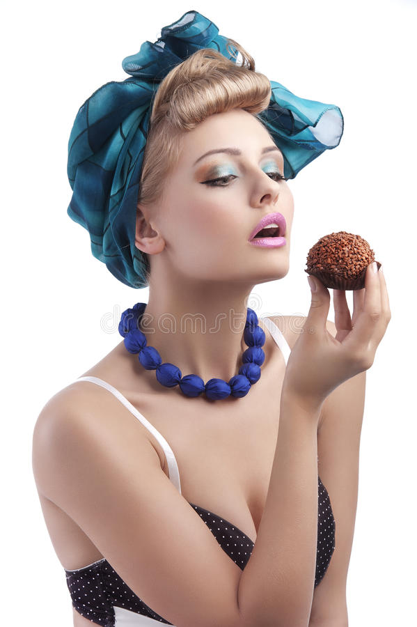 Blond young girl longing to eat a sweet stock photos