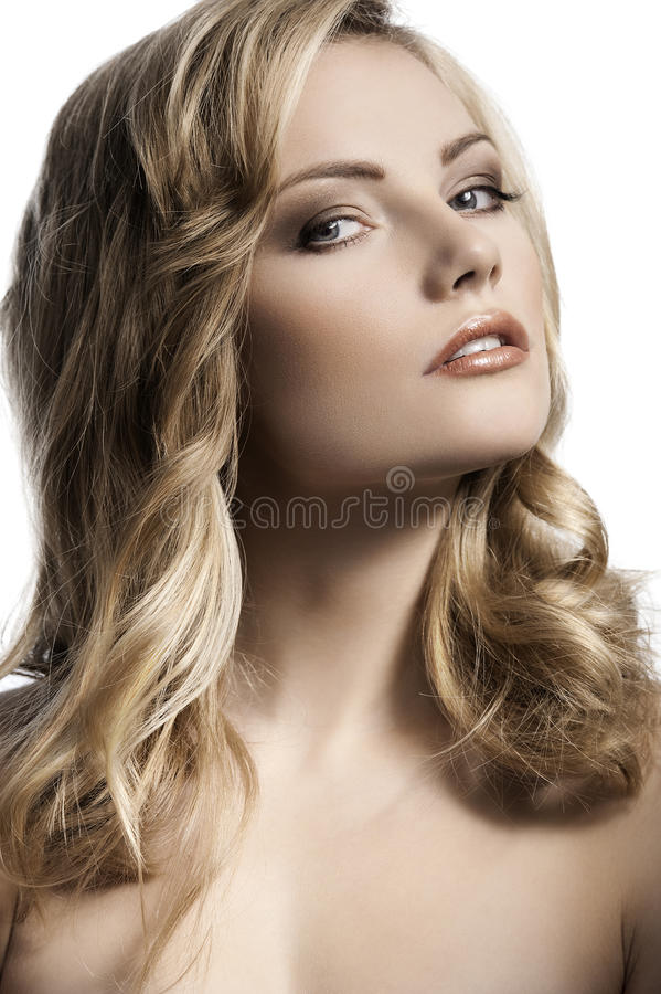 Blond young girl with stylish curled hair royalty free stock image