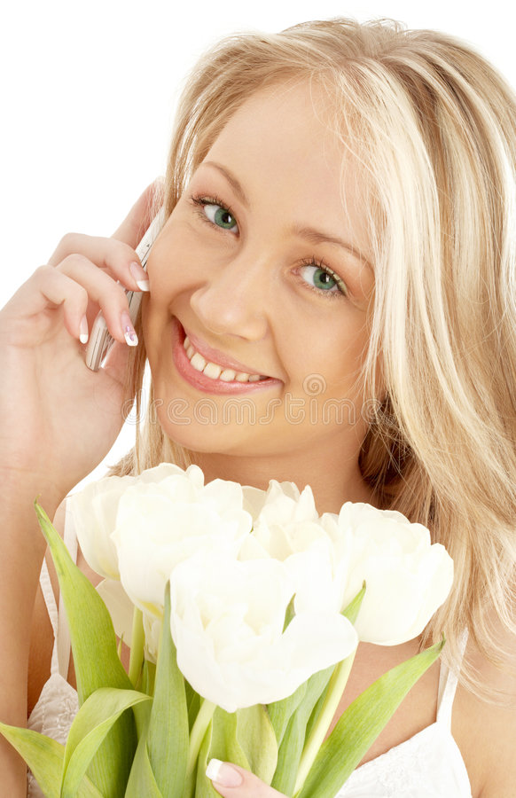 blonda gladlynt vita telefontulpan royaltyfri foto