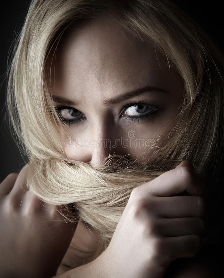 Blonde adult woman royalty free stock photography