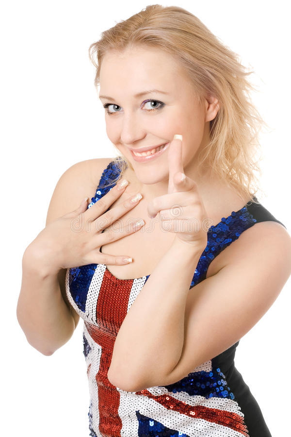 Blonde alegre que mostra seu forefinger fotografia de stock royalty free