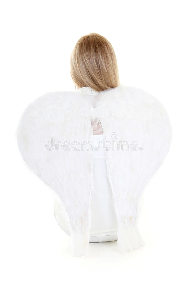 Blonde angel girl back with wings royalty free stock photography