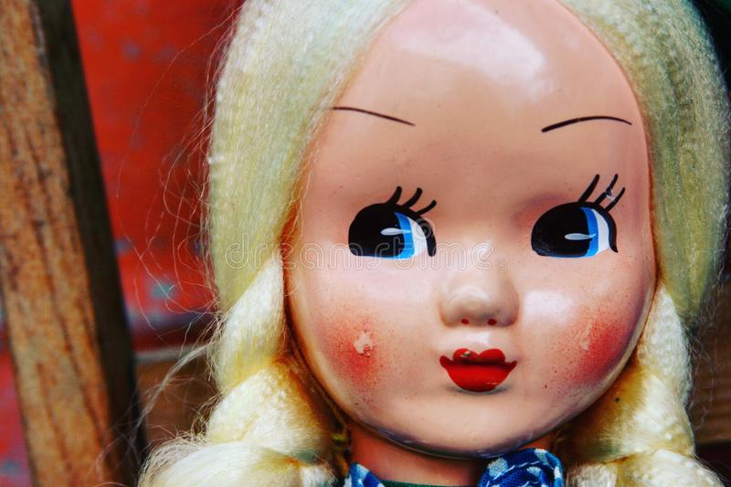 Blonde antique doll stock image
