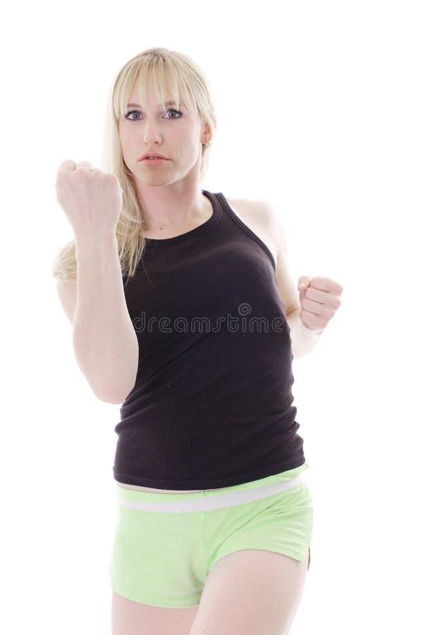 Blonde arrabbiato con i pugni in su fotografie stock