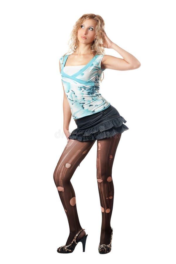 Blonde assez jeune dans le pantyhose déchiré image libre de droits