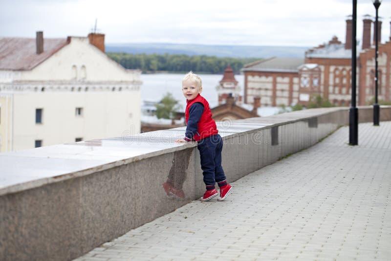 Blonde baby boy in autumn street park stock image