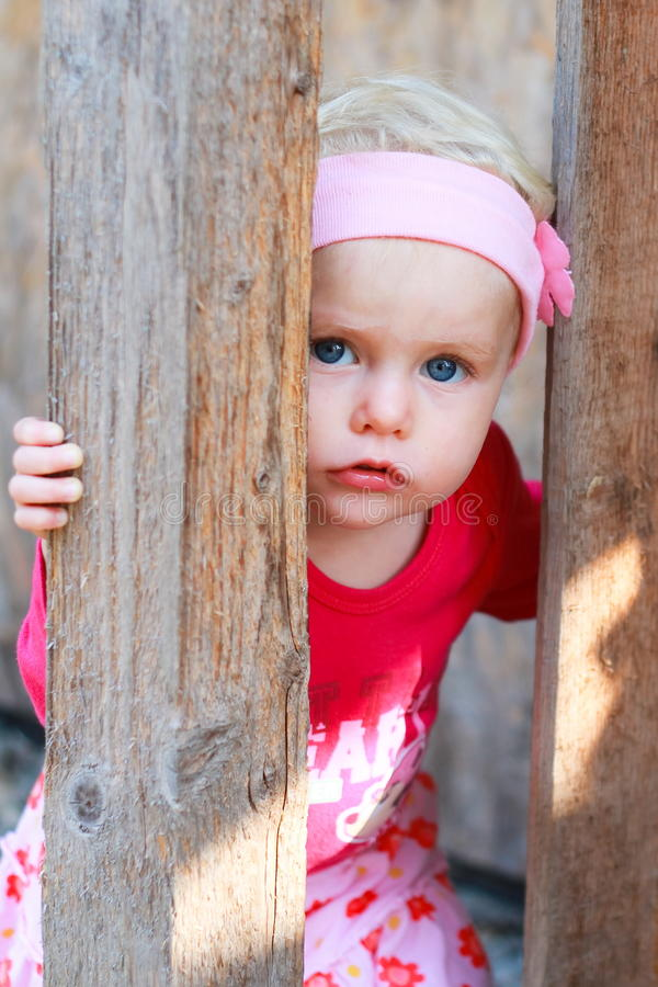 Blonde baby girl. Blonde blue eyed baby girl is playing royalty free stock photography
