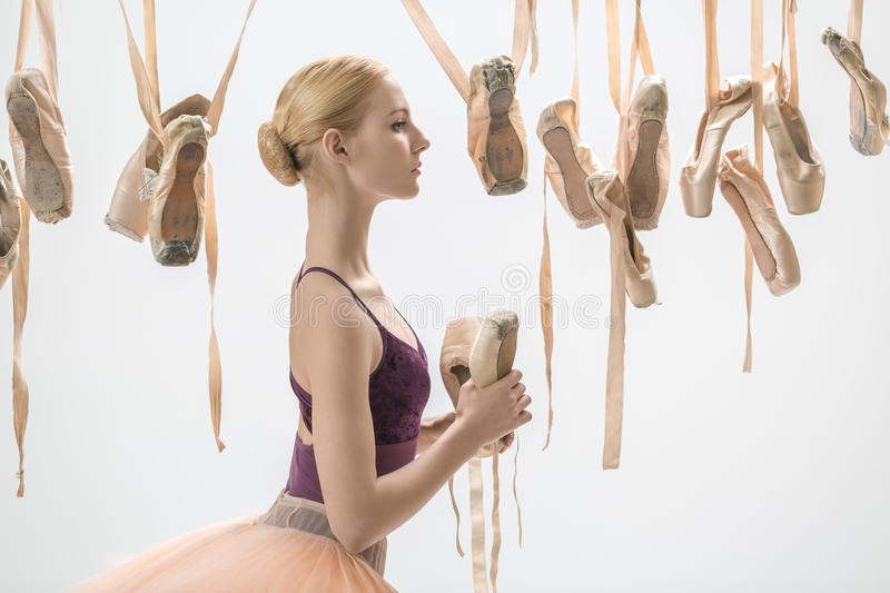 Blonde ballerina with pointe shoes royalty free stock photos