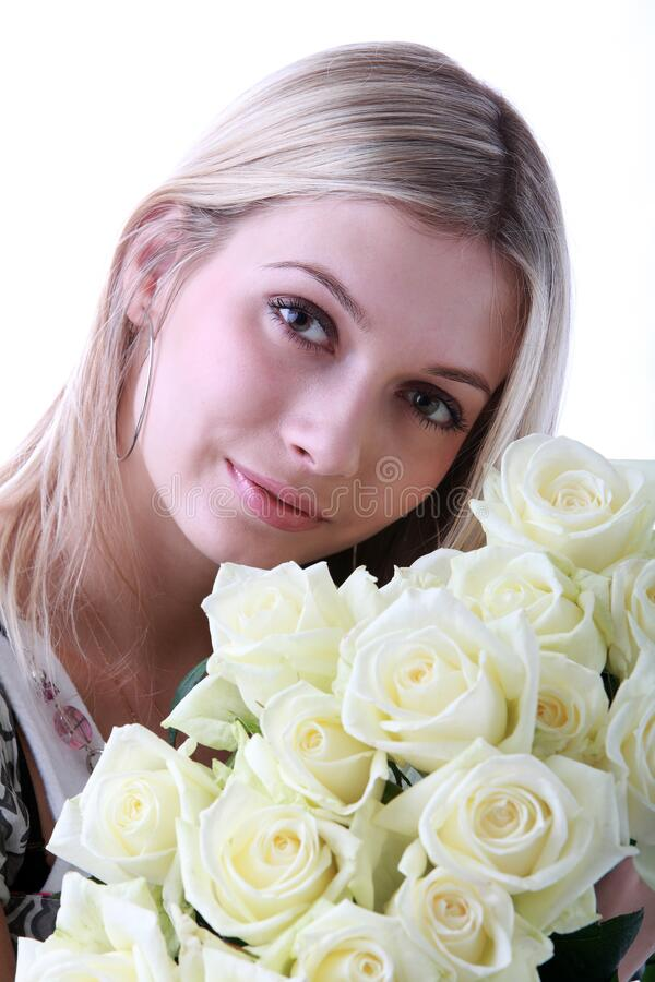Blonde beautiful girl with a bouquet of white roses royalty free stock photography