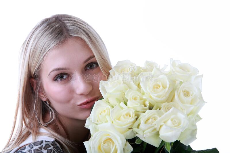 Blonde beautiful girl with a bouquet of white roses royalty free stock image