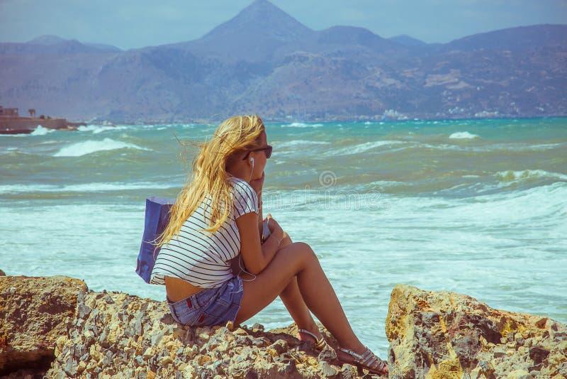 Blonde beautiful girl dreaming, at sea beach royalty free stock photography