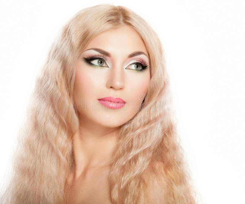 Blonde. Beautiful woman with bright makeup and blonde long hair royalty free stock photo