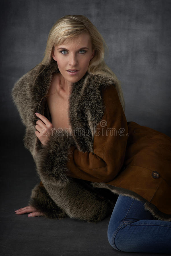 Blonde Beauty in Fur Coat royalty free stock photo