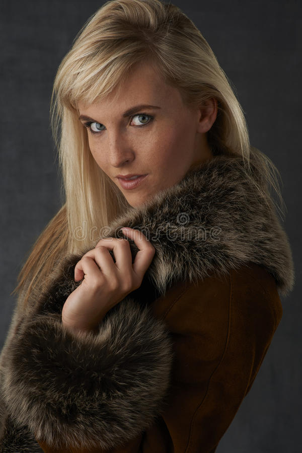 Blonde Beauty in Fur Coat stock image