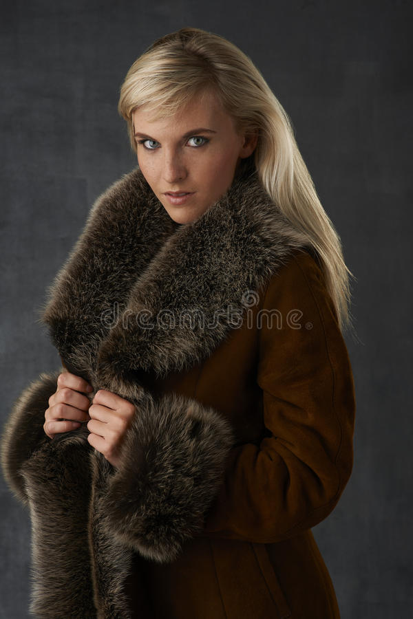 Blonde Beauty in Fur Coat stock photography