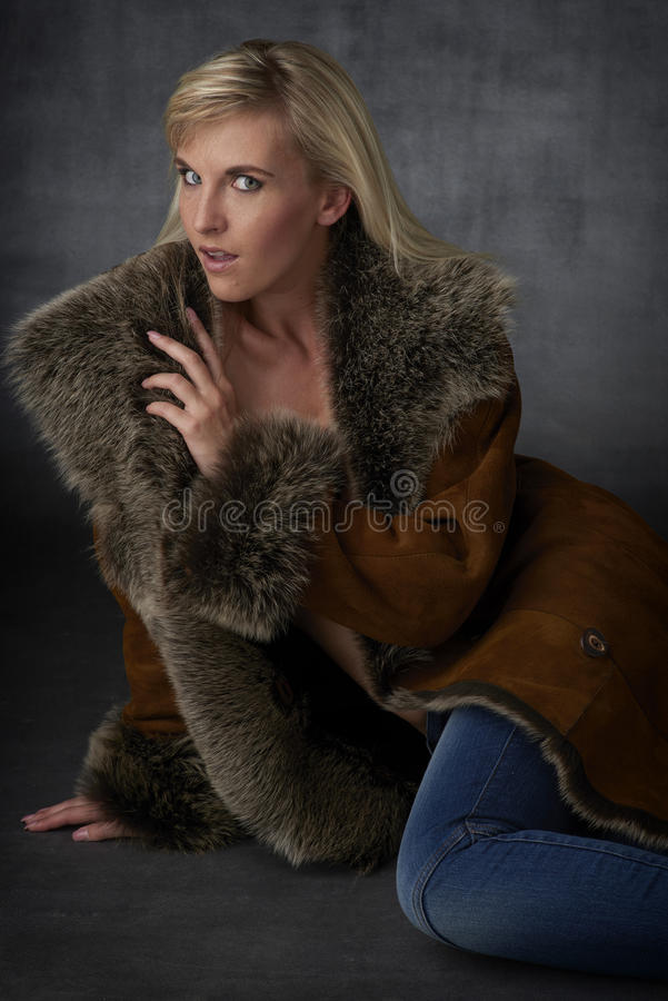Blonde Beauty in Fur Coat royalty free stock photo