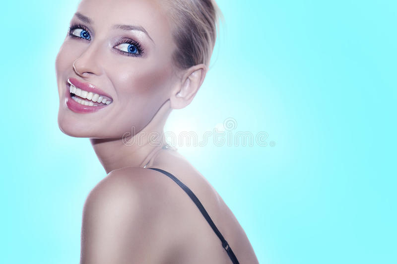 Blonde Beauty Posing With Toothy Smile. Royalty Free Stock Photography