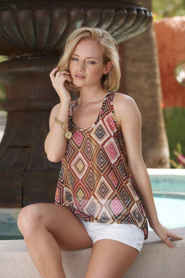 Blonde Beauty Rustic Garden Fountain stock image