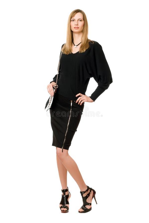 Blonde in black in full length stock image