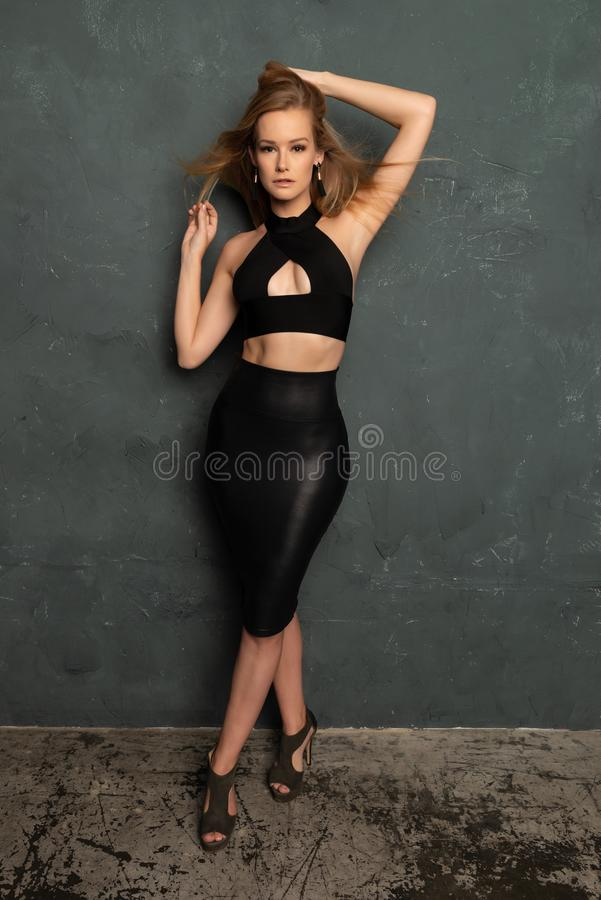 Blonde in black leather stock images