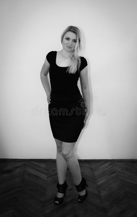 Blonde in black skirt royalty free stock photo